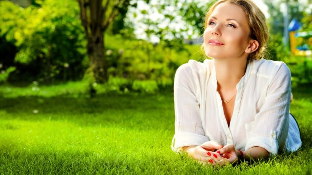 woman lying on a grass outdoor