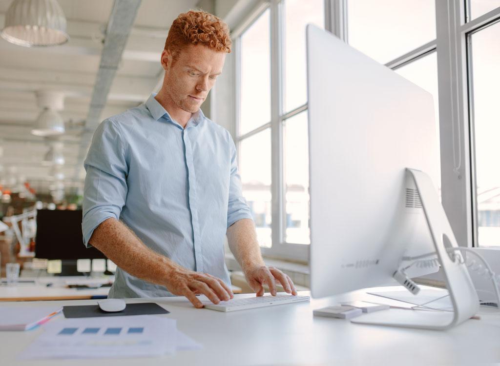 Man working at standing desk