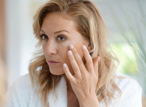Aging woman looking at wrinkles