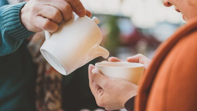 Couple pouring cup tea