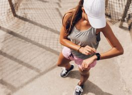 Woman looking at fitness watch on a run