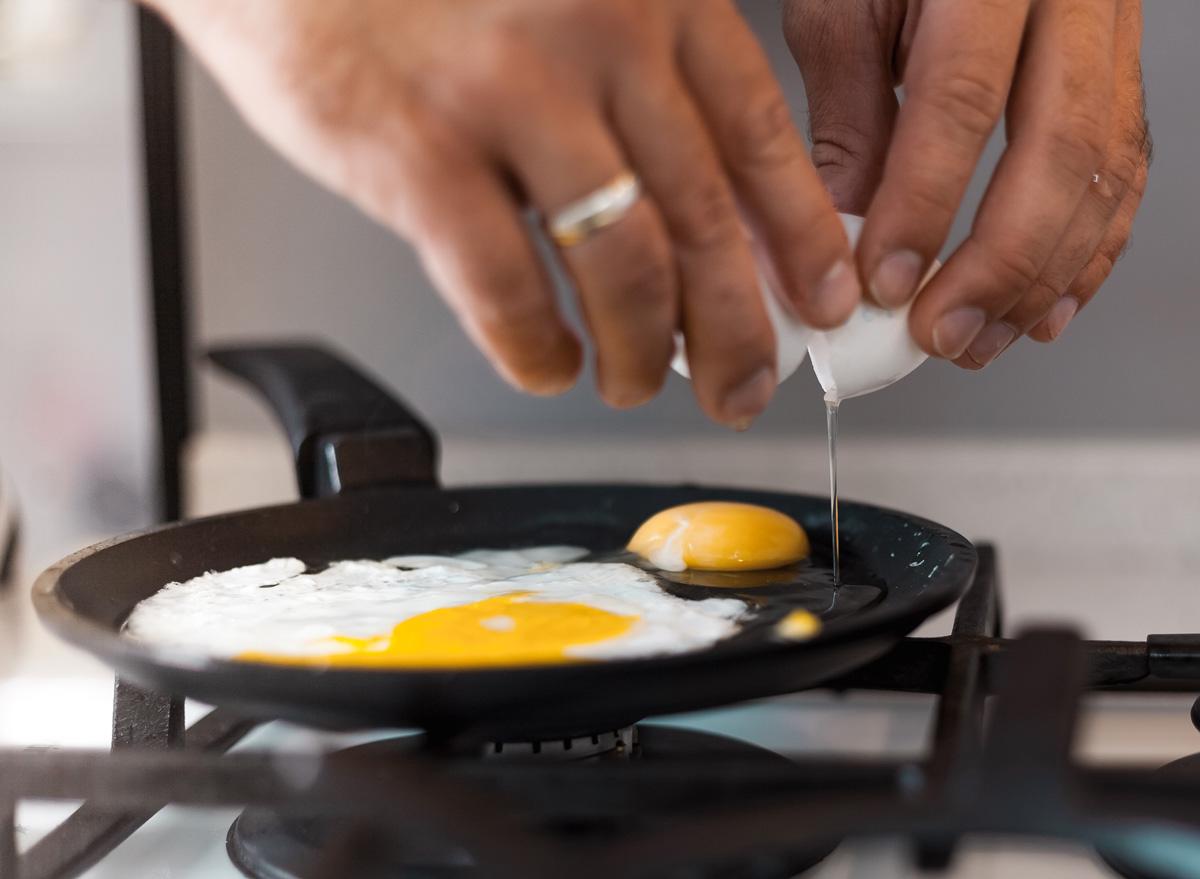 crack eggs into frying pan