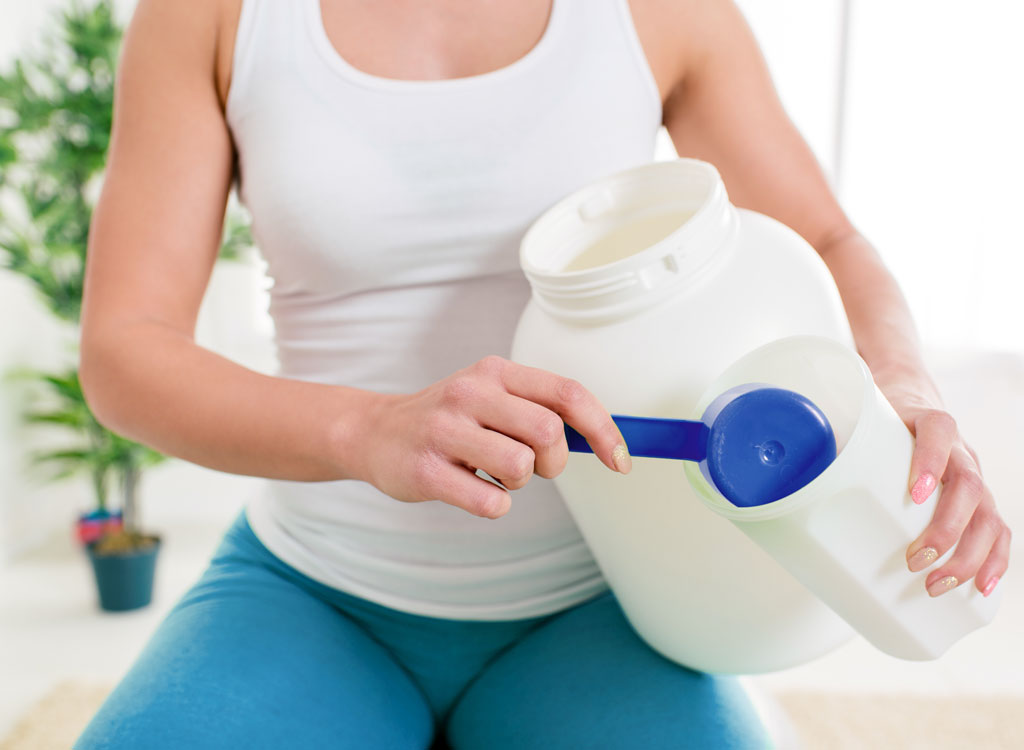 woman eating protein shake
