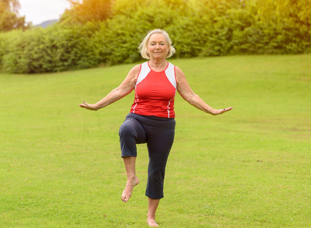 Woman balancing on one leg