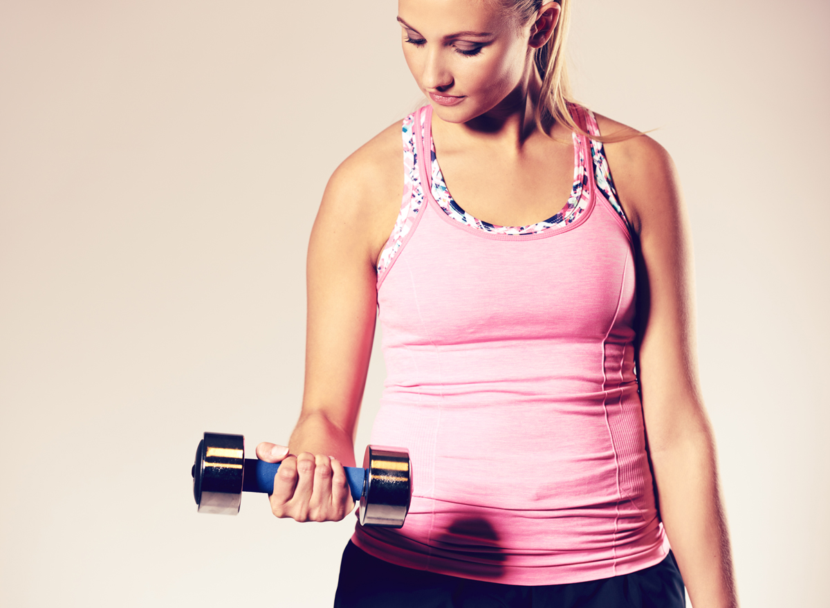 Woman holding dumbbell bicep curls