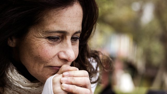 Woman thinking with wrinkles