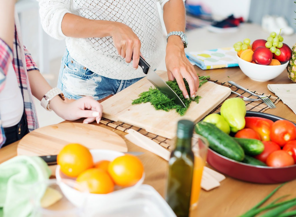 Cooking and cutting vegetables at home