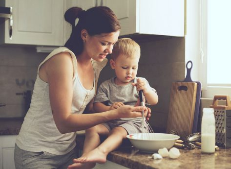 Busy mom cooking with child