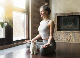 Woman cat yoga