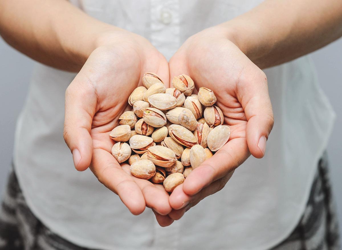 Holding pistachio snack in hands