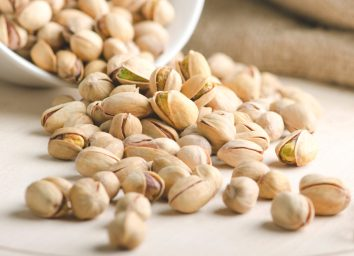 Pistachios falling out of bowl