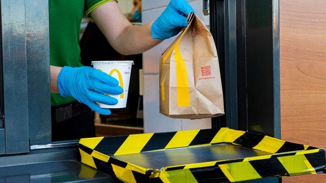 mcdonalds drive thru employee wearing gloves
