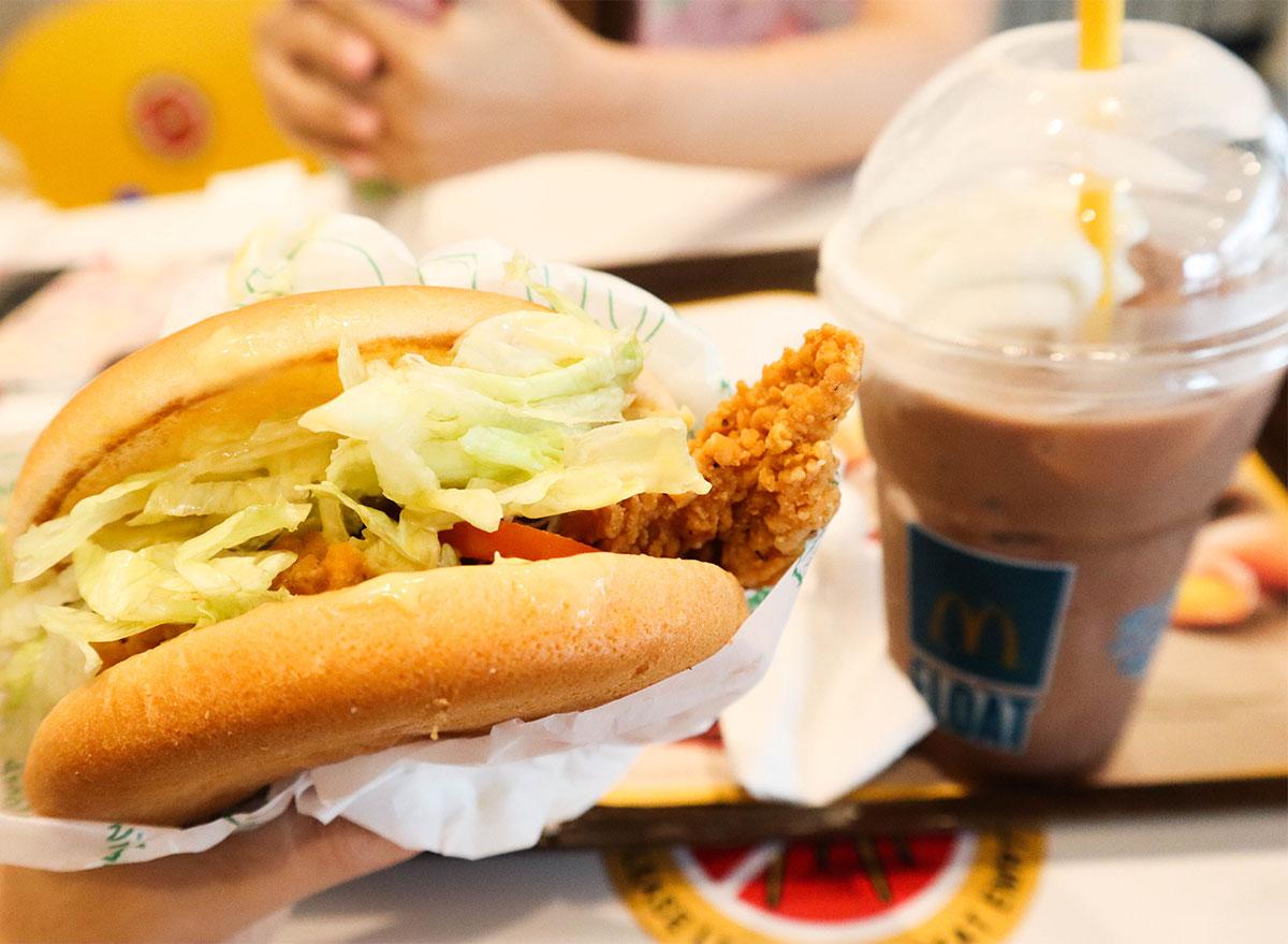 mcdonalds milkshake mcfloat with chicken sandwich on tray
