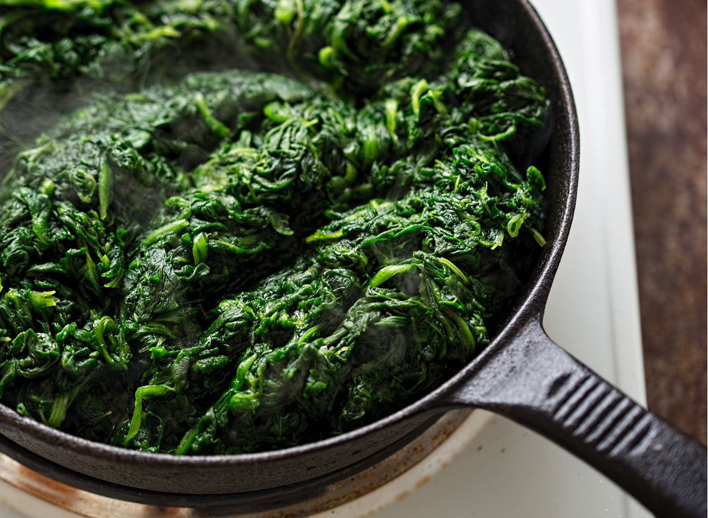 Saute frozen spinach in a cast-iron pan