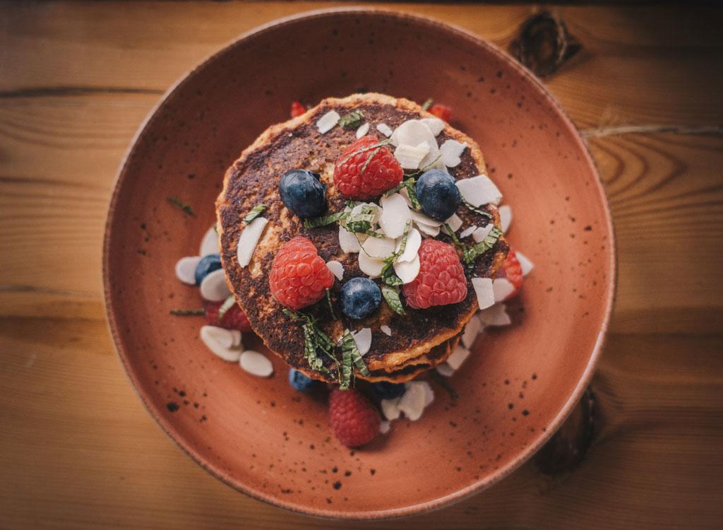 Pumpkin pancakes coconut flakes berries mint