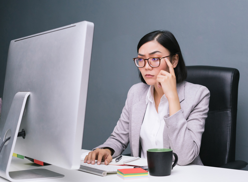 Woman working at desk - always hungry reasons
