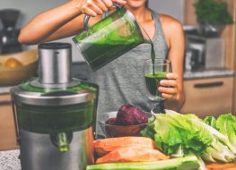 Woman pouring green detox juice