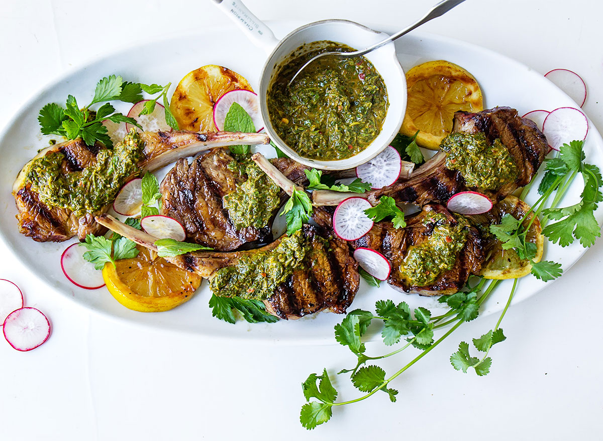 grilled lamb chops with sauce on serving platter