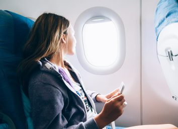 Woman sitting in an airplane
