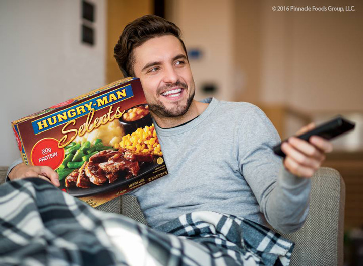 Man with Hungry-Man frozen dinner
