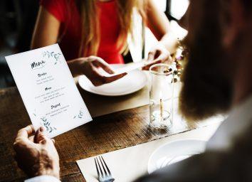 Man reading dinner menu