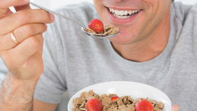 Man eating high fiber breakfast cereal