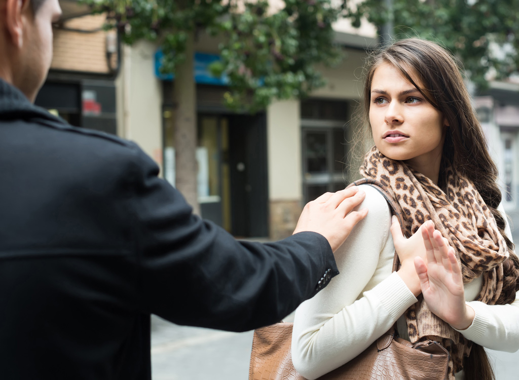 Man confronting woman