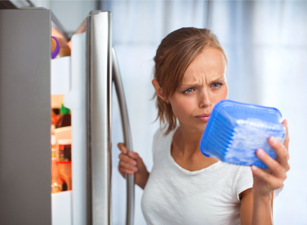 Woman checking expiration date on food