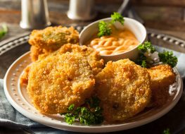 fried green tomatoes and sauce on plate