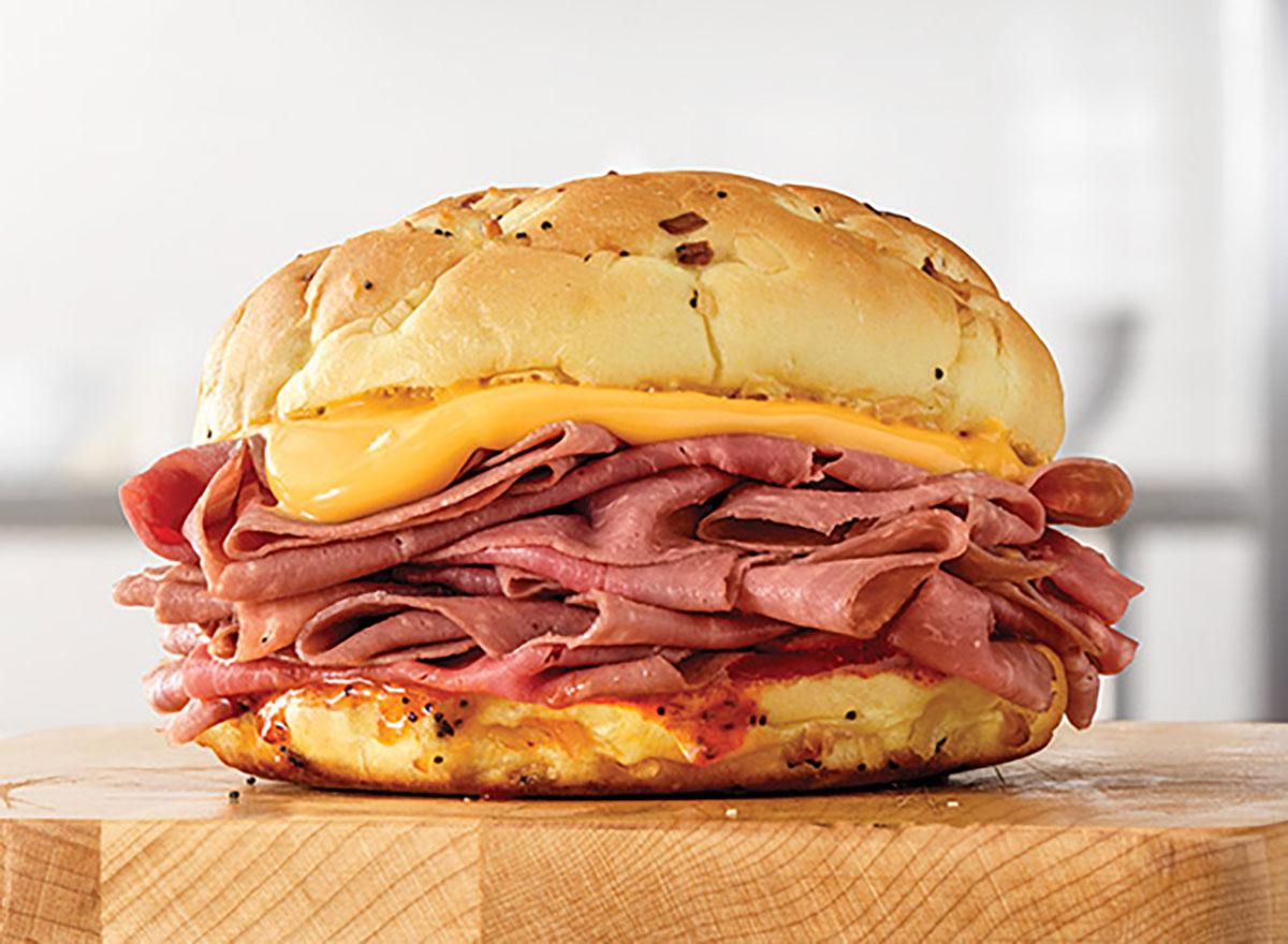 arbys beef n cheddar sandwich on wooden block