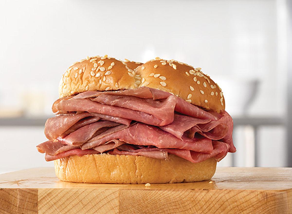 arby's classic roast beef sandwich on wood block