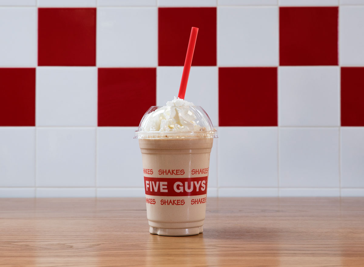 five guys chocolate milkshake with whipped cream and red straw