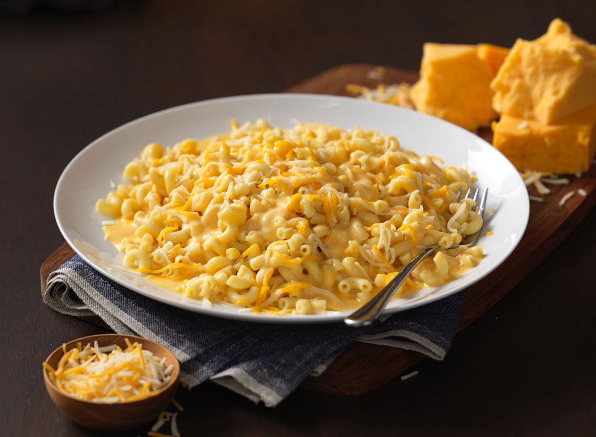 noodles world kitchen wisconsin mac and cheese bowl with spoon and cheese wedge