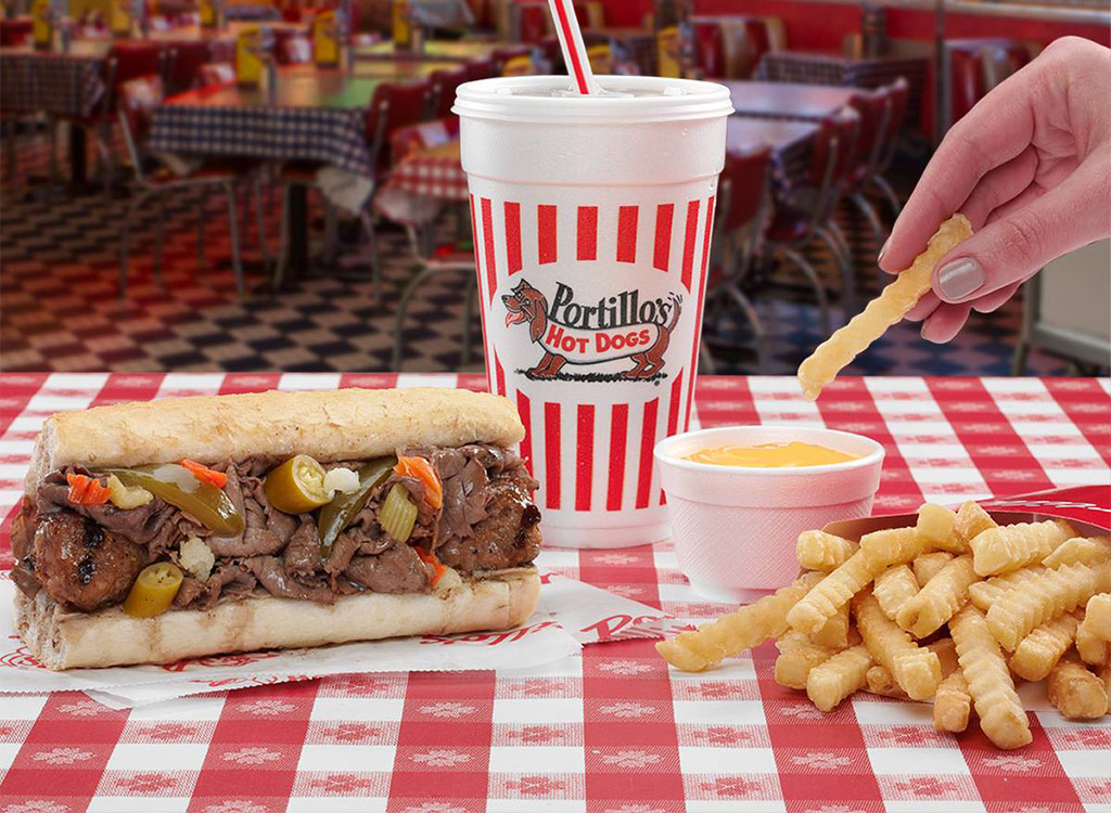 Portillos hotdogs and fries dipping in sauce