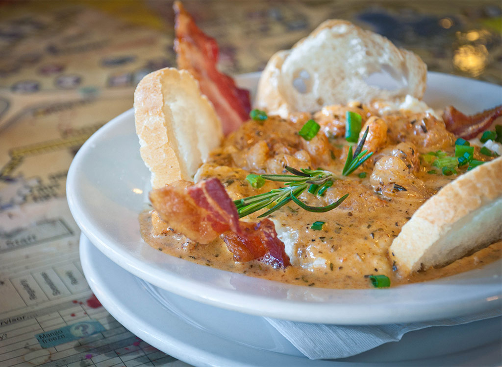 shrimp and grits in bowl with bread