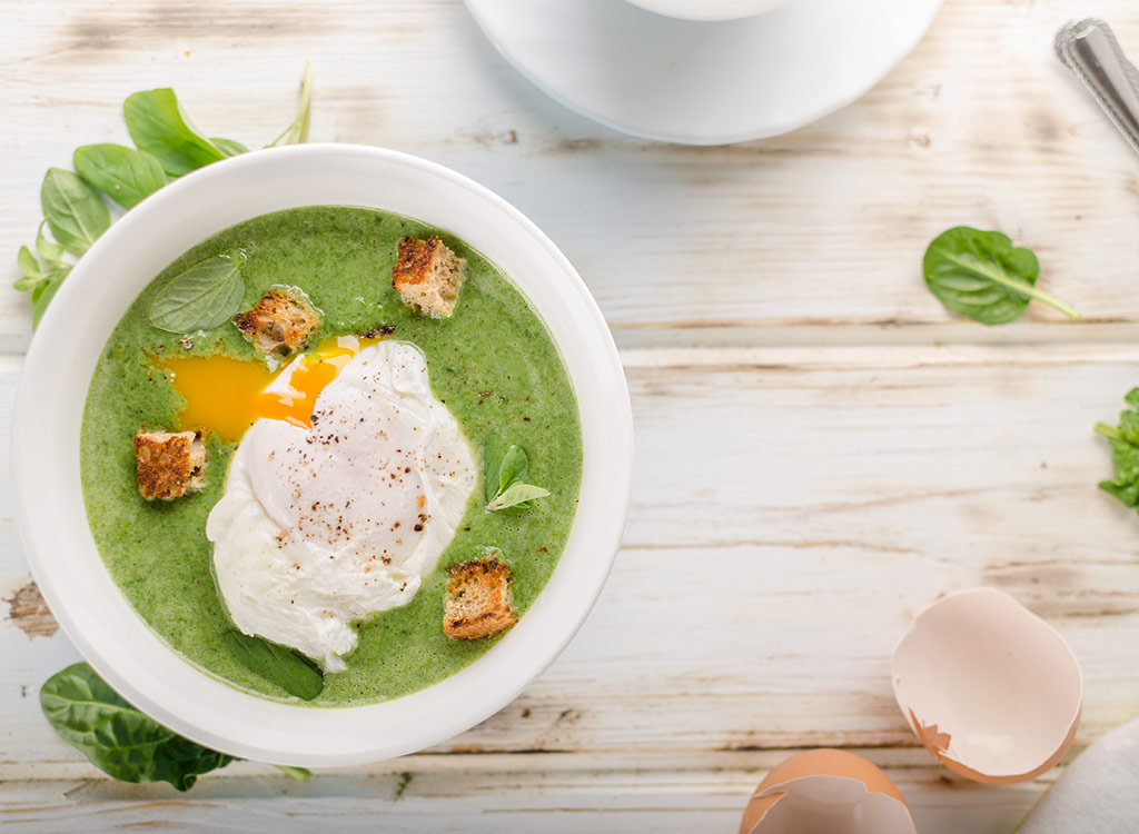 Veggie soup with poached egg