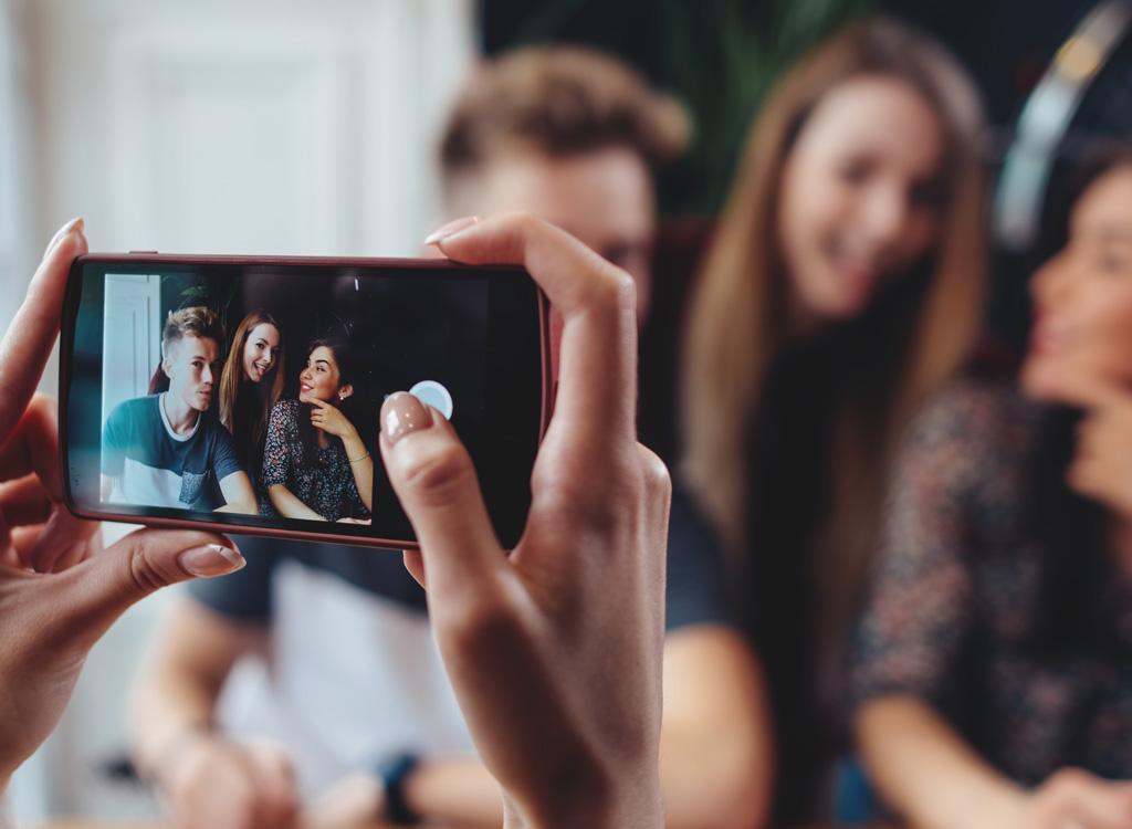 Woman taking group photo phone