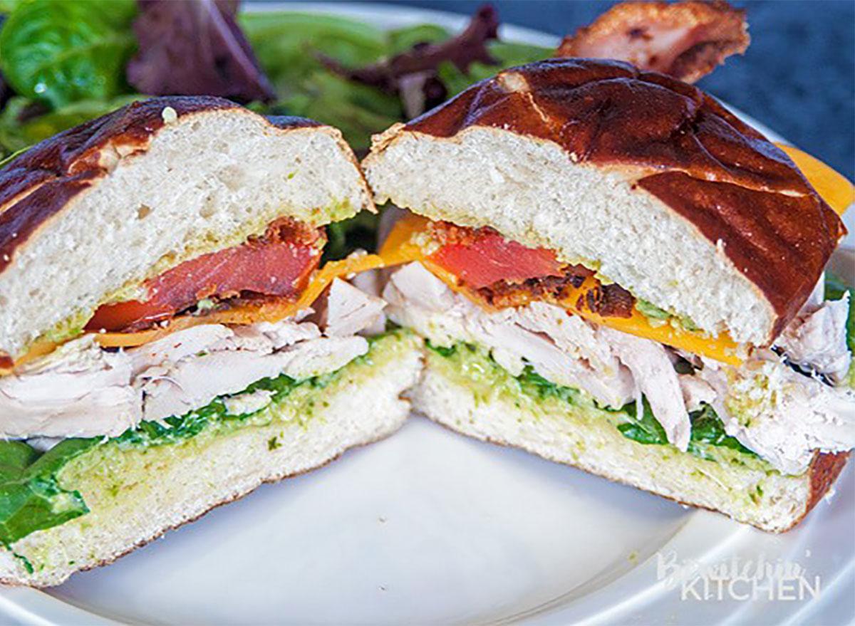 chicken club sandwich on pretzel bun
