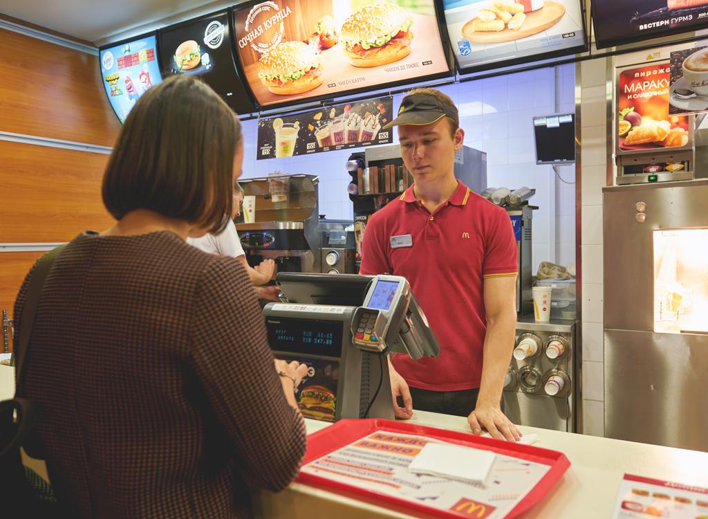 Fast food worker taking order
