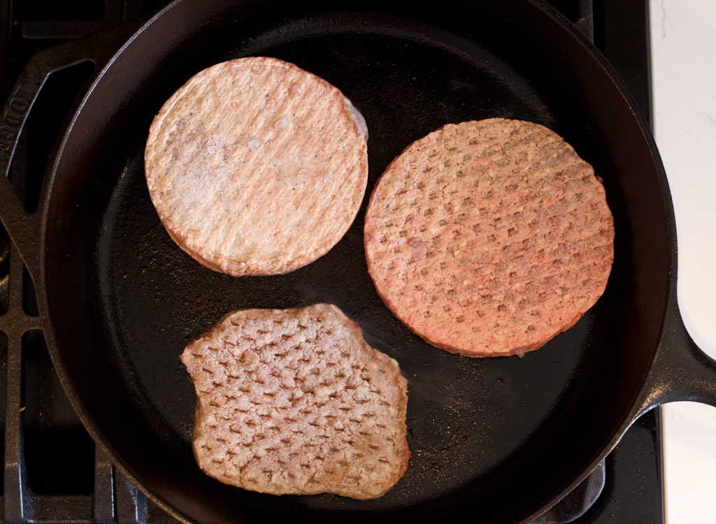 Frozen burgers in pan