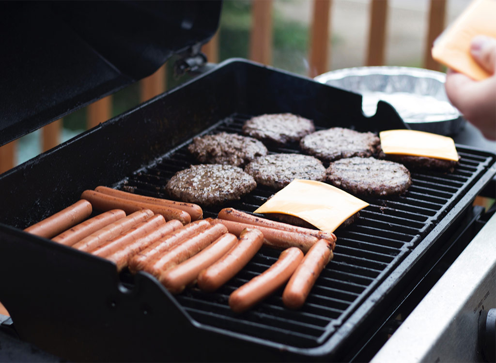 Hot dogs and burgers on grill