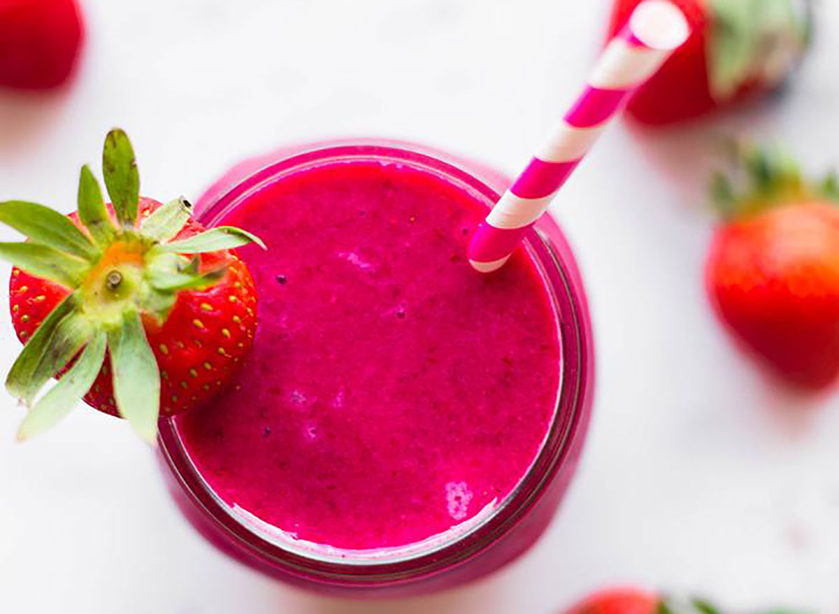 pink protein beet smoothie with straw