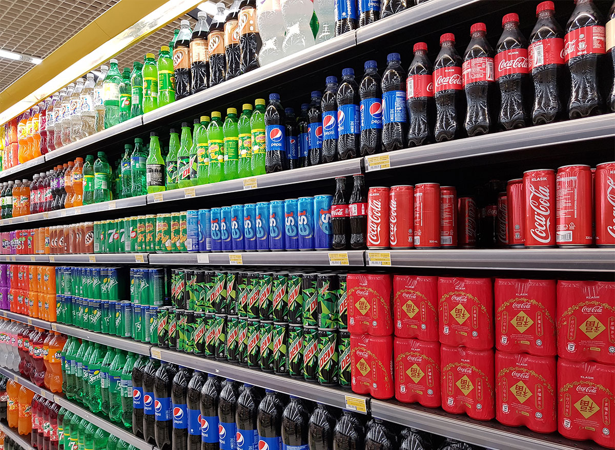 soda aisle with cans and bottles of soda