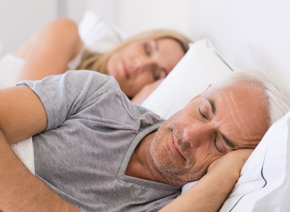 Older couple sleeping soundly together