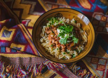 Rotini pasta with meat sauce and cilantro