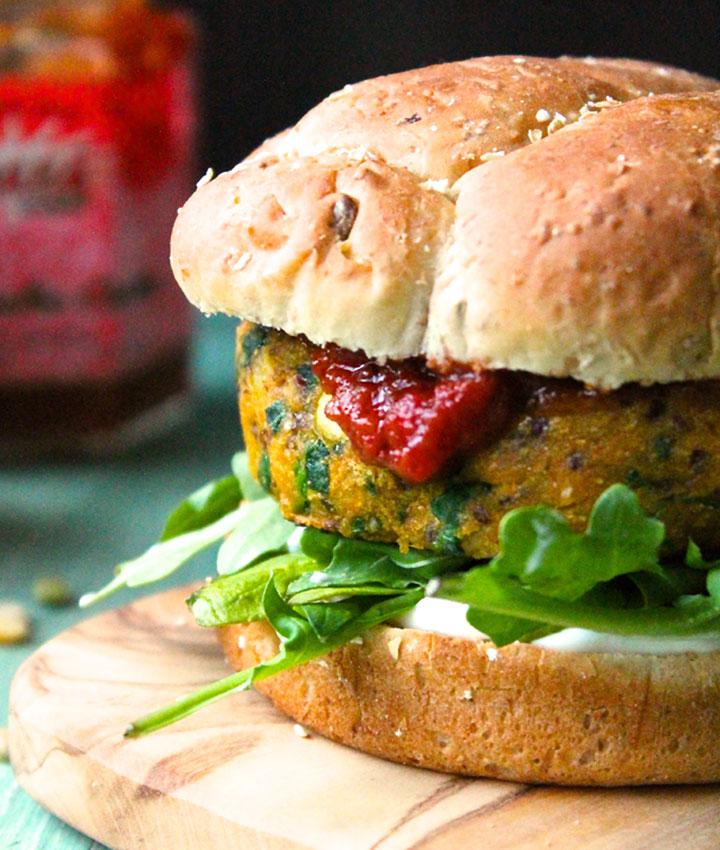 Vegan curried sweet potato burger with tomato chutney and cilantro aioli