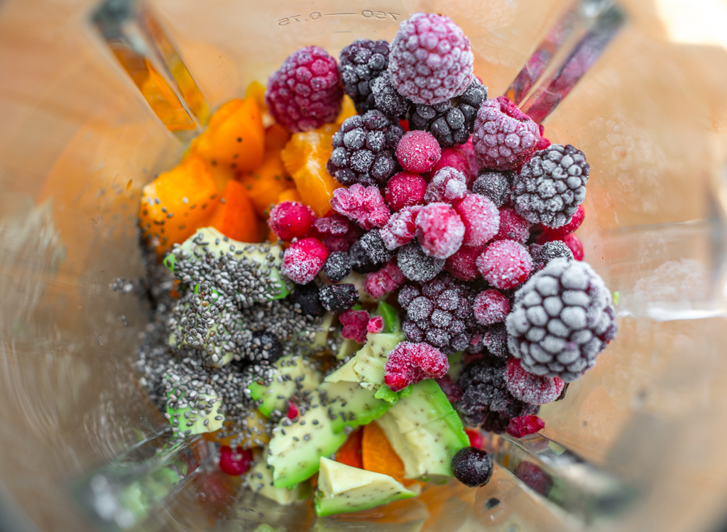 Avocado berries chia seeds in blender for smoothie - avocado weight loss