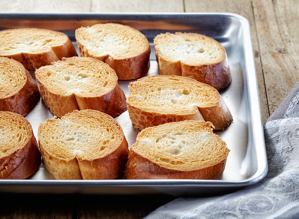 slices of toasted baguette on baking sheet
