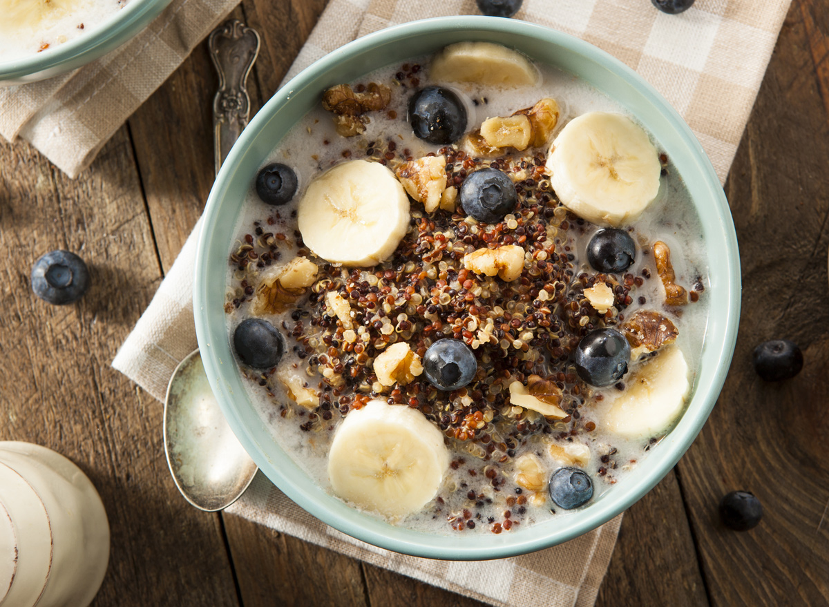 Breakfast quinoa bowl with bananas and blueberries