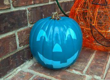 Teal pumpkin project painted jack o lantern